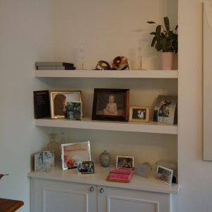 Fitted beaded cupboard and floating shelves